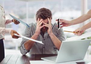 Zähneknirschen Ursachen: Stress am Arbeitsplatz